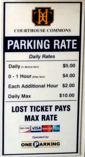 Photograph of a pricing sheet for a parking garage